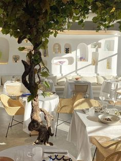Whitewashed walls and colourful ceramics channel sunny climes inside Paris restaurant Oursin, designed by Simon Porte Jacquemus. Deco Restaurant, Restaurant Design, Restaurant Interiors, Restaurant At Paris, Coast Restaurant, Cafe Interiors, Rustic Restaurant, Rattan Dining Chairs, Jacquemus