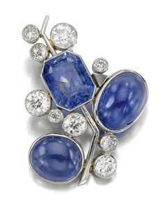 JEWELS FROM THE PERSONAL COLLECTION OF SUZANNE BELPERRON. Of stylised floral and foliate design, set with a step-cut and cabochon sapphires and circular-cut diamonds.  SAPPHIRE AND DIAMOND BROOCH, 'FLEUR', CIRCA 1945
