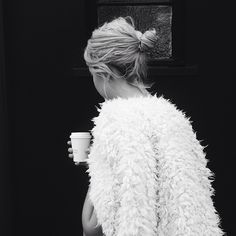 All a girl needs in life is a good cup of coffee and a great coat