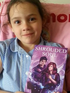 Eleanor modelling my preview copy of Shrouded Soul (Hidden: Book 3).