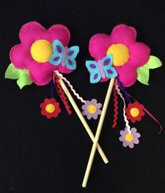 Here is a handcrafted magical flower fairy wand. All wand designs are original and made to order, they are handsewn together and then fastened onto a wooden dowel handle with added ribbon and ricrac . These are perfect for any little fairy! Not recommended for children under 3 years