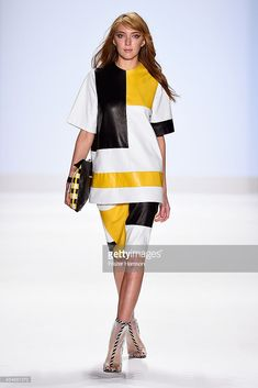 A model walks the runway at the Project Runway fashion show during Mercedes-Benz Fashion Week Spring 2015 at The Theatre at Lincoln Center on September 5, 2014 in New York City.