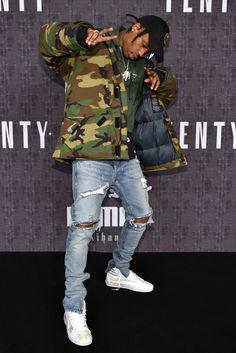 Travis Scott front row at Fenty x Puma by Rihanna RTW Fall 2016 [Photo: WWD/REX/Shutterstock]