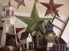 Google Image Result for http://www.amishwares.com/images/site/common/en/image/imagewrap.img%3Fpicture.image.url%3Dhttp://www.amishwares.com/members/1504461/uploaded/primitive_birdhouses_and_barn_star_grouping_optimized.jpg%26picture.width.max%3D450