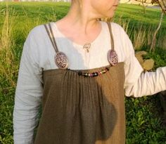 """The front of the dress worn by """"Britt"""" showing pleats between the brooches as well as in the back.  Apparently it was inspired by the Kostrup find."""