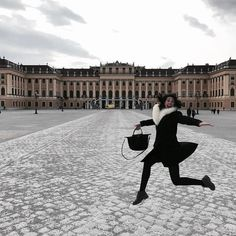 Hopping over life obstacles like...⬆️ #delusion #dancing #giselle #moments #snowwhite #nodwarfs #royal #palace #courtyard #gardens #entrance #shonnbrun #black #princess #Vienna #austria #antelope #jump #travel #europe #backpacker #travelblogger #black #duster #timberland #longchamp #white #fur #rayban