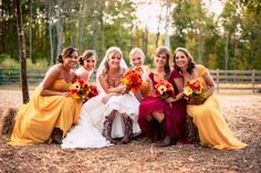 These gorgeous bridesmaids wore such a beautiful blend of orange + red for this very radiant fall wedding! ::Amanda + Jon's naturally beautiful fall wedding at the Crooked Pines Farm in Eatonton, Georgia:: #autumnwedding #georgiawedding #weddingphotography #bridalparty @Maricris Marron Pines