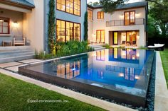Pool spills over edge + large windows