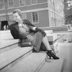 A model sits on a flight of steps to show off her scarlet wool Utility frock by Dorville at John Lewis and Co., with front-gathered skirt and shirt-waist top ~ 1940s Fashion, Vintage Fashion, Turban Outfit, Make Do And Mend, 1940s Dresses, Hollywood Glamour, Fast Fashion, Women's Fashion, World War Ii