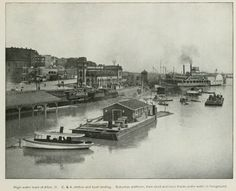 Alton riverfront during the 1903 flood. Shown is the Chicago & Alton Union Station and boat landing. In the foreground, the suburban platform, train shed and levee tracks are under water.