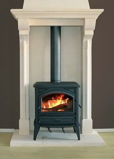 Multi Fuel stove and stone surround Wood Burner Fireplace, Modern Fireplace, Fireplace Ideas, Corner Wood Stove, Stoves For Sale, Indoor Outdoor Fireplaces, Multi Fuel Stove, Freestanding Fireplace, Log Burner