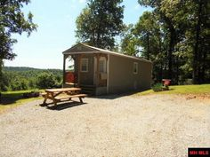 """""""Lucky You"""" This tastefully remodeled 14 x 55 Home sitting on 4.95 ac/ml, with wonderful Ozark Country views, features a 10 x 12 Deck, and a log cabin feel. Located only 2 miles from Lake Norfork Boat Launch & only 3 miles from the Norfork River you get the best of both worlds. Property has 2 RV hookups, and a new 12 x 40 1 bedroom/ 1 bath fully equipped cabin for possible rental income, or extra space for friends and family to join you while you enjoy the area in Jordan AR"""