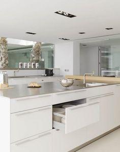 Pure white kitchen island with storage drawer units