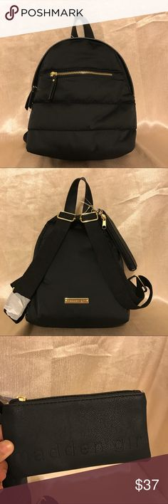 SALE!NWT MADDEN GIRL SMALL BLACK BACKPACK MSRP$58 This Brand new w/ tag Madden Girl small backpack is on mega sale!$37 only.Cute and trendy that has a beige polkadot design in the inside. It's a mini bag but it has to definitely a big space to put your favorite items! It also goes with the mini purse where you can put your pens or your make up. Has one pocket outside and one pocket in the inside. Size8 1/2(l)x10 1/2(h)x3 1/2 bag depth. Body:100% Nylon Trim:100% PU Lining:100% Polyester.Ready…