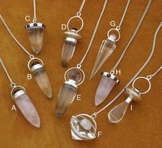 """Clear quartz and rose quartz crystal solid sterling silver and gemstone pendulums for dowsing, healing and meditation. All gemstones are natural. All have silver chains that are approximately 6""""/15.2cm long. These are not Lemurian quartz and are from high quality clear quartz crystals found in India.  #crystal #quartz #pendulums"""