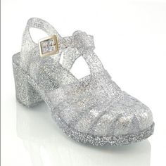 Silver Glitter Heel Jelly jellies Size 10 New in the box. I'm a true size 9 and these fit perfect. They are clear with silver glitter. Bamboo Shoes Heels