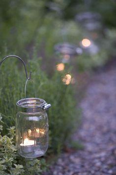 Karin Lidbeck, mason jars as garden edging lights. Wonder if I could find solar lights that could go in them. Mason Jar Garden, Mason Jars, Canning Jars, Glass Jars, Deco Nature, Outdoor Lighting, Outdoor Decor, Lighting Ideas, Pathway Lighting