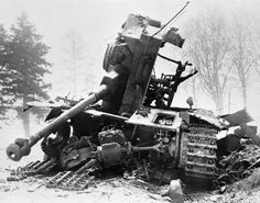 The Battle of the Bulge 16 December 1944 - 28 January 1945: A shattered German tank, its turret torn off by anti-tank fire, symbolising the ferocity of the American defence of their positions at Bastogne, the key town in the Ardennes. The tank's chaccis has been ripped open by the explosion exposing the power plant and the main gearbox in the foreground.