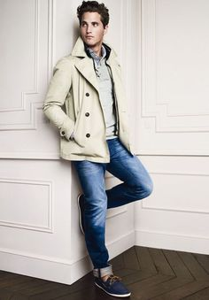 Shop this look on Lookastic:  http://lookastic.com/men/looks/longsleeve-shirt-and-v-neck-sweater-and-pea-coat-and-jeans-and-tassel-loafers/3781  — White and Navy Vertical Striped Long Sleeve Shirt  — Grey V-neck Sweater  — Beige Pea Coat  — Navy Jeans  — Navy Suede Tassel Loafers