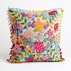 This intricately handwoven accent pillow features the bright pinks, yellows and greens of spring. It is sure to brighten any room you decorate. Peruvian Floral Pillow | National Geographic Store