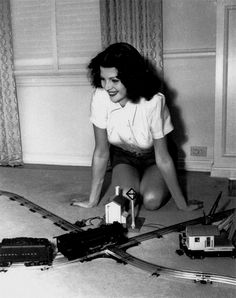 A young Rita Hayworth with her Lionel train set, c. late 1930's