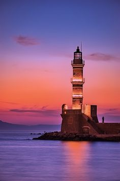 I'm fairly certain that this is the lighthouse of the apostle, in Chania Crete! I have photographed this seawall and lighthouse myself!