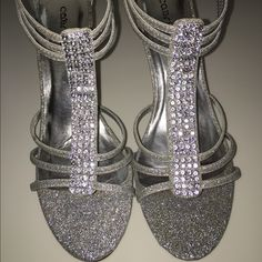 Dressy silver heels! Shiny glitter and bedazzled heels! Perfect for prom! Only worn once for a formal banquet. Size 10 women's! Cabrizi Shoes Heels