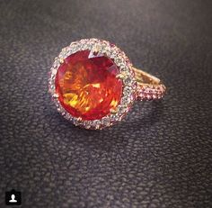 5ct orange garnet. Accented by pink sapphires and diamonds #diamonds