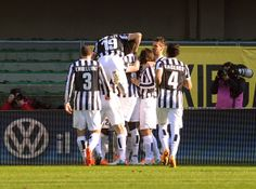 Carlos Tevez of Juventus is mobbed by their team mates after scoring his  opening  goal during the Serie A match between Hellas Verona FC an...