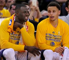 Golden State Warriors' Draymond Green (23) and Stephen Curry (30) watch from the bench as their team plays the Memphis Grizzlies in the fourth quarter of Game 1 of the Western Conference NBA semifinals at Oracle Arena in Oakland, Calif., on Sunday, May 3, 2015. (Susan Tripp Pollard/Bay Area News Group)