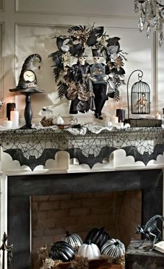 Looking to buy some beautiful Halloween Decorations. Grandinroad has some amazing pieces. I love this mantle with pumpkins in the fireplace and a spider webbed bat runner. 31 Inspiring Halloween Mantles and Tablescapes to dress up your home this October Season on Frugal Coupon Living.