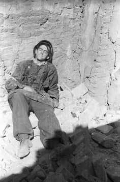 A Warsaw partisan Jerzy Sikorski, who possessed the codename Sixton, of Anna company of the Gustav battalion resting in the ruins of a house