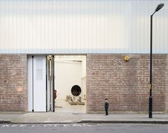 Image 1 of 28 from gallery of Anish Kapoor Studios II, III, IV, V, VI & VII / Caseyfierro Architects. Photograph by Jim Stephenson Anish Kapoor, Facade Architecture, Contemporary Architecture, B720, Types Of Bricks, Clerestory Windows, Urban Fabric, Large Artwork, Brick Facade