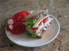 Bread is Pepperidge Farm Wheat Lite style, the turkey is from the deli. We used Kraft 2% Swiss cheese (all Swiss is very low in sodium). Top with mustard, tomatoes (from the garden), lettuce, and grated carrots.  tomatoes, radishes 2 servings of veggies  add some baby carrots, some light yogurt or a glass of nonfat milk, and a small piece of fruit and then you have a total of 3 servings of vegetables, 2 dairy and one fruit.