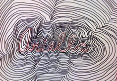 """Students reviewed the term """"Op Art"""" that they learned when they were younger and they created a picture that can play tricks with your eyes. They wrote their name in cursive and then traced around and around their name as many times as it took to fill up the negative space on the paper. From far away it may look like a normal picture, but when you get up all close all the lines begin to """"move"""" and play tricks on your eyes."""