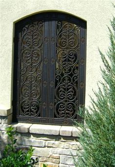 Faux Wrought Iron Exterior Window by tvonschimo, via Flickr