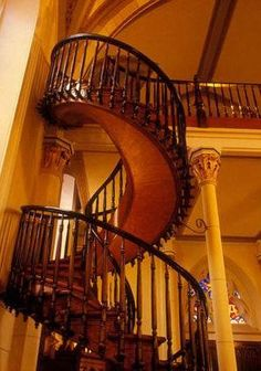 Loretto Chapel staircase in Santa Fe. . It was built by a mysterious carpenter who showed up after the nuns prayed to St. Joseph. He used no nails or modern tools. It was fastened only with wood pegs.