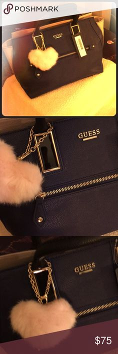 Price marked down for couple hours It's a beautiful trendy guess bag blue and skin colour with black handles and chained long strap  Can he wear as satchel or cross body  Great for giving a gift for Christmas  Plus am giving away a urban decay pallet to the first buyer who will shop for hundred dollar from my closet check out my closet for detail Guess Bags Satchels