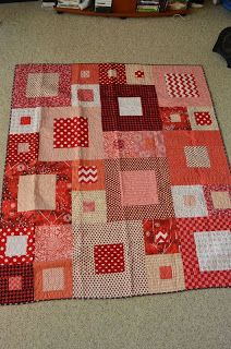 Red squares framed.  Bright, cheerful, fairly simple.  At Alycia Quilts:  http://alyciaquilts.blogspot.com/2013/07/quilts-of-valor-717.html
