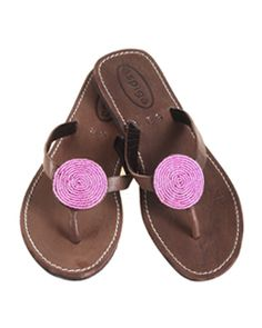 Aspiga Pink Disc Sandals This Disc sandal is a leather flip flop, on a rubber flat sole, with a small disc of hand sewn beads. http://www.comparestoreprices.co.uk/womens-shoes/aspiga-pink-disc-sandals.asp