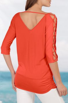 Sexy, unexpected details make this a must-have blouson top with its open back detail and strappy crisscross cutout sleeves.• Polyester/spandex.• Imported.• Machine wash.• Sensuously shaped: skims the body.• Sizes XXS(0), XS(2-4), S(6-8), M(10-12), L(14-16), XL(18).
