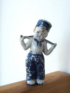 Absolutely charming chippy porcelain figurine of Dutch boy marked Made in Japan    5.75 tall    Lots of peeling paint :)      11