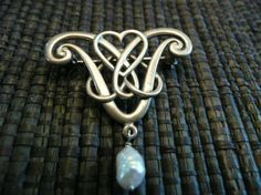 Silver art nouveau brooch with pearl