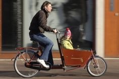 I would love to get one of these to bike my kids around in. It is way cooler than towing them behind in a trailer.