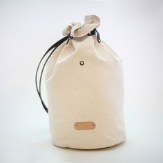 04bf807afc9 Leather Canvas Bag / Large Durable Canvas/Cotton Drawstring Backpack With  LeatherShoulder Strap from ionnoi on Etsy.