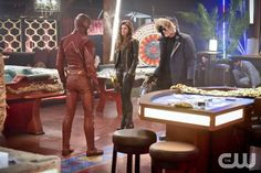 """The Flash -- """"Rogue Time"""" -- Image FLA116B_0301b -- Pictured (L-R): Grant Gustin as Barry Allen / The Flash, Peyton List as Lisa Snart, and Wentworth Miller as Leonard Snart/Captain Cold -- Photo: Dean Buscher/The CW -- © 2015 The CW Network, LLC. All rights reserved.pn"""