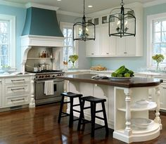 White and Turquoise kitchen where everything works.  Great overhead lighting, range hood pops with a darker shade of blue.