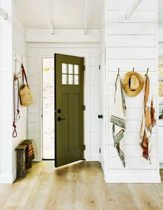 As soon as you step into designer Sam Sacks' breezy and bohemian cottage, an earthy green door sets the tone. Cabana, Rustic Bench, Rustic Chic, Front Door Colors, Living Room Seating, Color Trends, Decorating Your Home, Sweet Home, New Homes