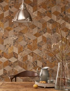 This hexagon shaped mosaic is made up of diamond shaped natural stone pieces with a textured finish similar to tree bark. Comprising of travertine and limestone this large format mosaic creates a warm inviting space with rich tones of neutrals.