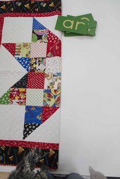 star quilt pattern using one charm pack and a background fabric.  A fan of charm packs, so love it!  -e